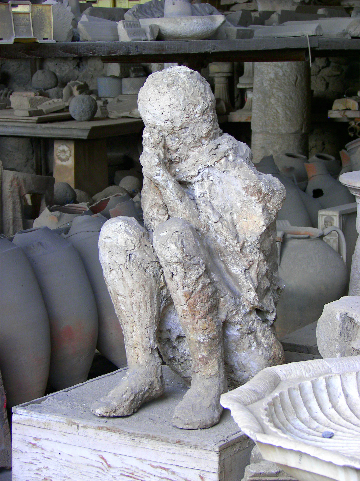 Plaster cast of a deceased person in the forum granary market in Pompeii